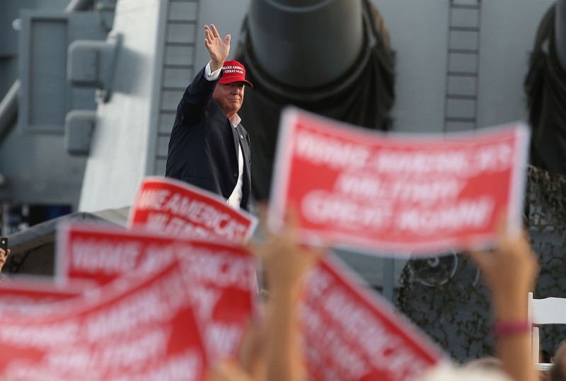 U.S. President Donald Trump greets supporters during a campaign rally aboard the USS Iowa on Sept. 15, 2015, in Los Angeles, California.