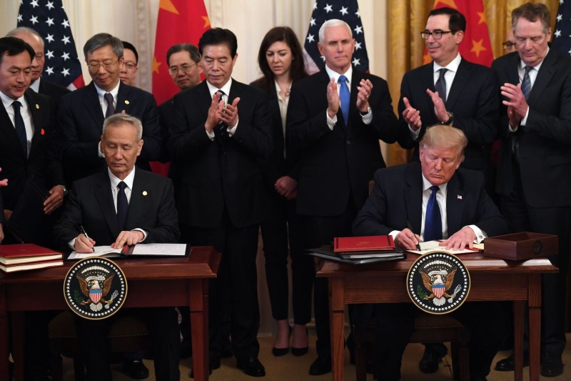 U.S. President Donald Trump, and China's Vice Premier Liu He, the country's top trade negotiator, sign a trade agreement in Washington on January 15.