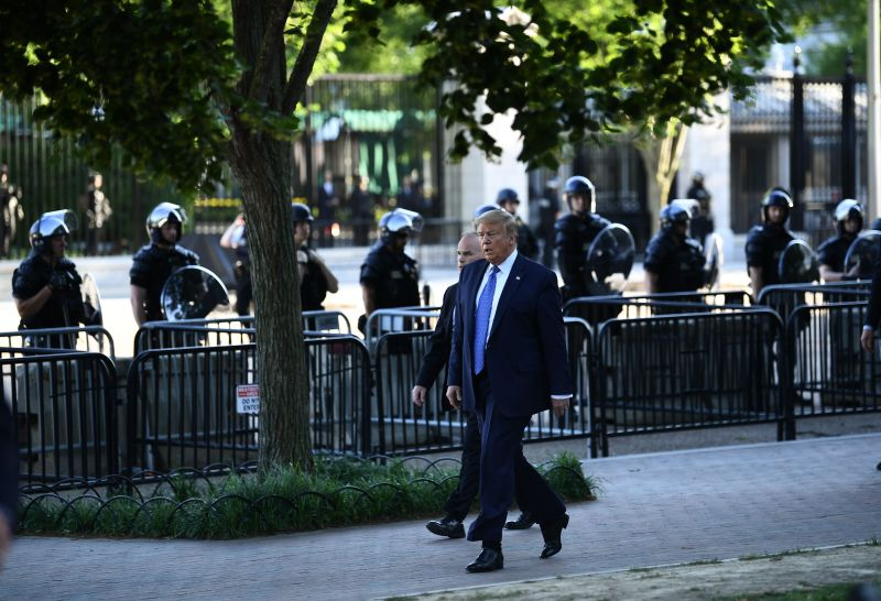 U.S. President Donald Trump walks back to the White House after spending time in front of St. John's Episcopal church in Washington, DC on June 1.