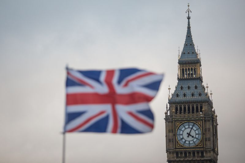 A U.K. flag flies in front of Big Ben in London
