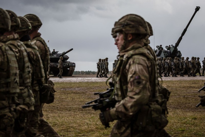 U.S. and Polish troops take part in the official welcoming ceremony for NATO troops in Orzysz, Poland, on April 13, 2017.