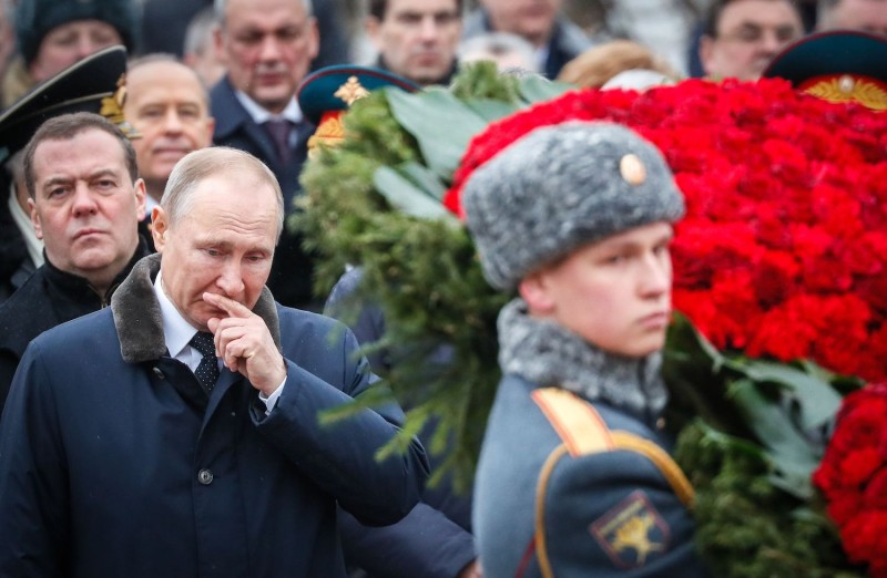Russian President Vladimir Putin attends a wreath-laying ceremony.