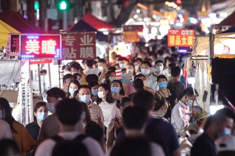 Residents visit a reopened night market in Wuhan, China on June 3.