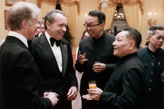 U.S. President Jimmy Carter (left), former President Richard Nixon (second left), and Chinese leader Deng Xiaoping (right) speak at a state dinner in honor of Deng's visit to the United States in January 1979.