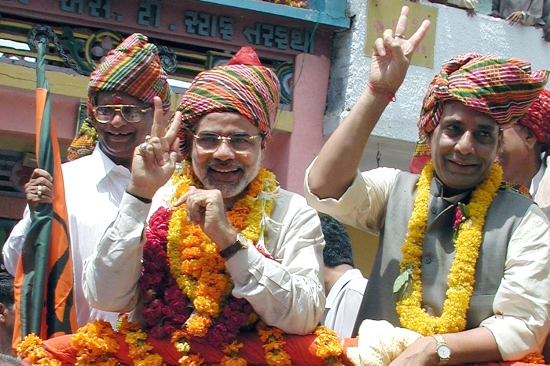 Modi (center), at the time chief minister of the western Indian state of Gujarat, flashes a victory sign during a march in the village of Faghval, India, on Sept. 8, 2002.