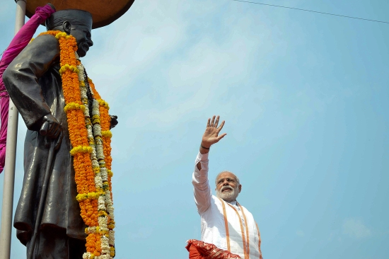 Modi waves to a crowd in Varanasi, India, on March 4, 2017, while paying tribute to the Hindutva ideologue Madan Mohan Malaviya.