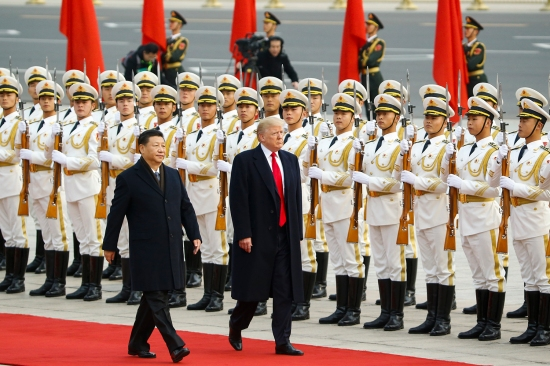 U.S. President Donald Trump takes part in a welcoming ceremony with Chinese President Xi Jinping in Beijing on Nov. 9.