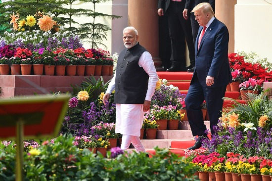 Indian Prime Minister Narendra Modi (left) and U.S. President Donald Trump arrive for a joint press conference in New Delhi on Feb. 25.