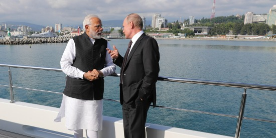 Indian Prime Minister Narendra Modi (left) and Russian President Vladimir Putin confer on a boat in the Black Sea on May 21, 2018.