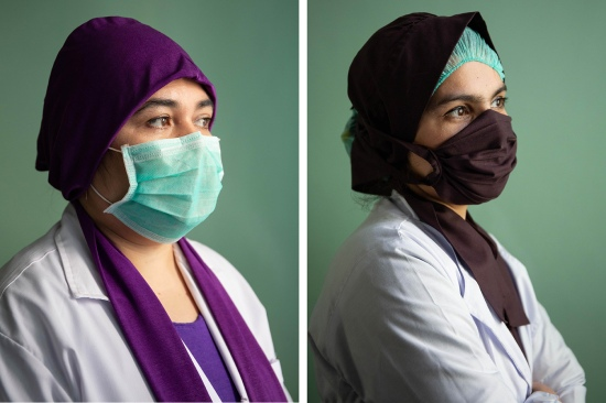 Mazia Azimi, left, and Sitara Habibi are longtime midwives at Mirwais Hospital.