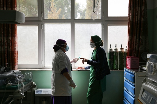 Azimi talks to a surgeon in the delivery ward at Mirwais Hospital on Feb. 17.