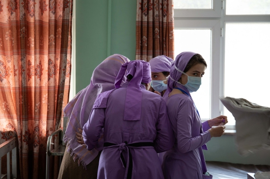 Midwife trainees prepare the labor ward for the first patients of the day at Mirwais Hospital on Feb. 18.