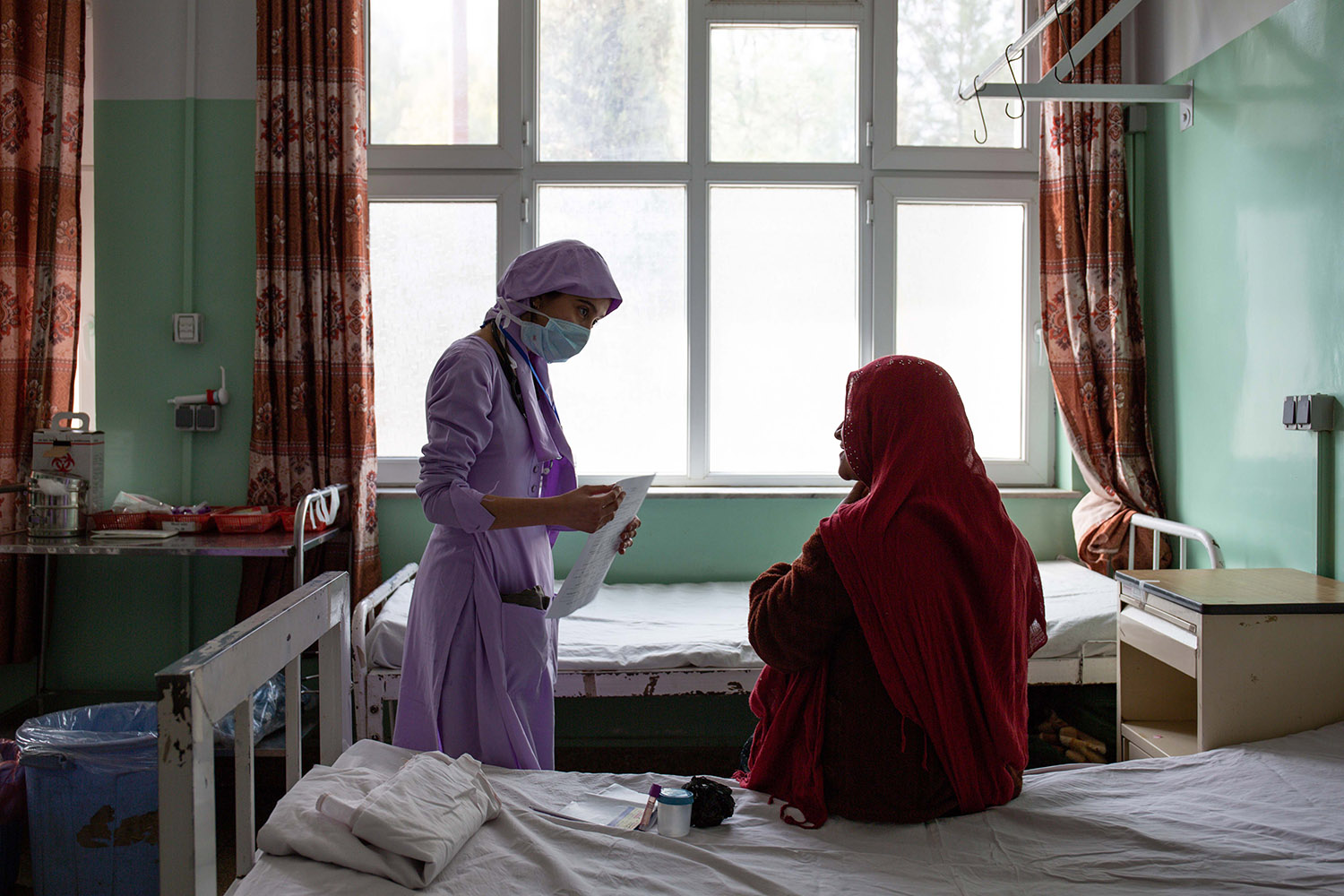A midwife in training attends to one of the first patients of the day in the labor ward at Mirwais Hospital on Feb. 18.