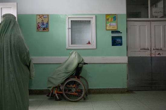 Women in labor wait in the corridor outside the maternity ward at Mirwais Hospital on Feb. 19.