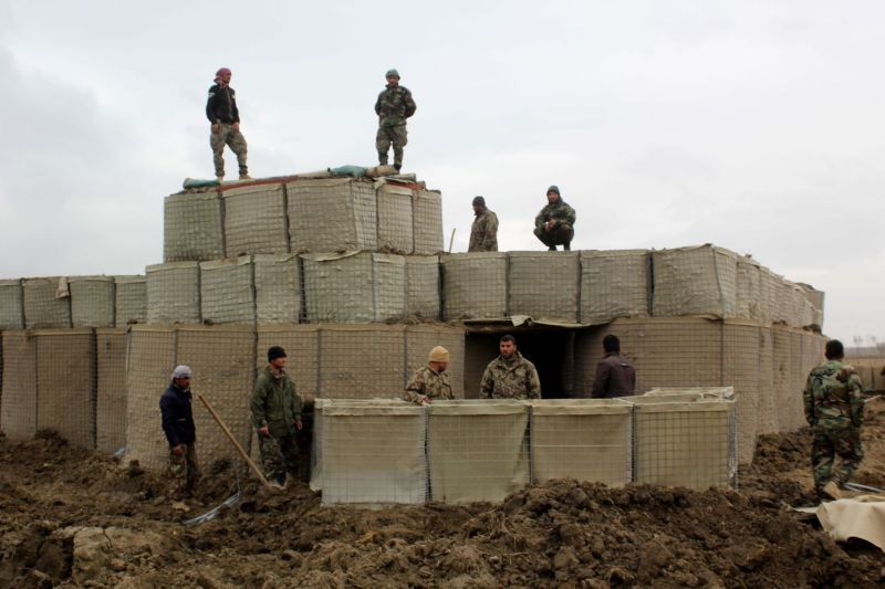 Afghan security forces stand guard at an Afghan National Army (ANA) outposts after an attack by  Taliban militants, in Kunduz Province on March 4, 2020.
