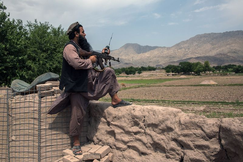 47-year-old Anar Gul, a local police commander, wields an AK-47 at his front-line outpost in Nangarhar's Surkhrod district in Afghanistan on June 24.