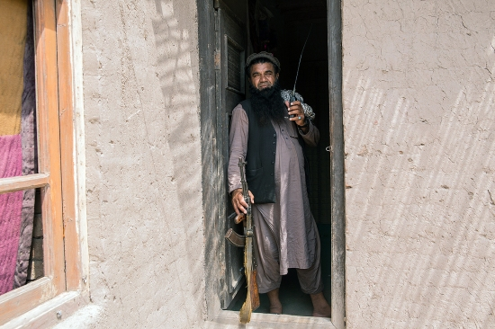 Anar Gul stands at his outpost in Nangarhar's Surkhrod district in Afghanistan on June 24.
