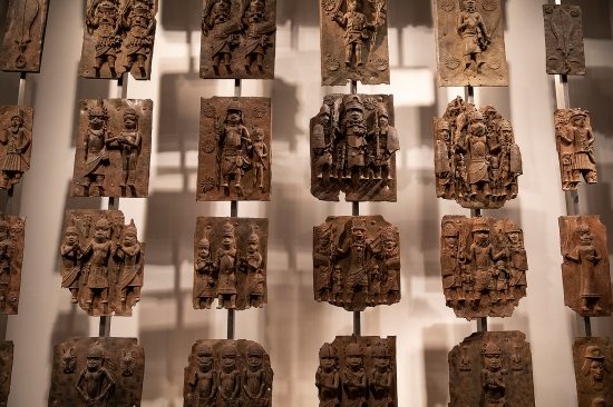 Plaques that form part of the Benin Bronzes are displayed at the British Museum in London on Nov. 22, 2018. The brass plaques were originally nailed to the doors and walls of the Benin royal palace. They commemorate past kings, military chiefs, and key events in Benin Kingdom.