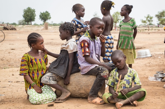 Children stand outside a school in Ouagadougou, Burkina Faso, on June 13, 2019. The school is being used as a shelter for internally displaced people from northern Burkina Faso who have fled intercommunal clashes.