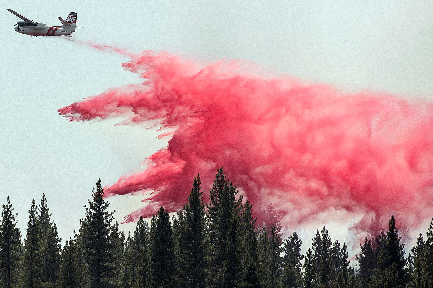 A Cal Fire aircraft drops fire retardant over the Hog Fire, about 5 miles from Susanville, California, on July 21. JOSH EDELSON/AFP via Getty Images