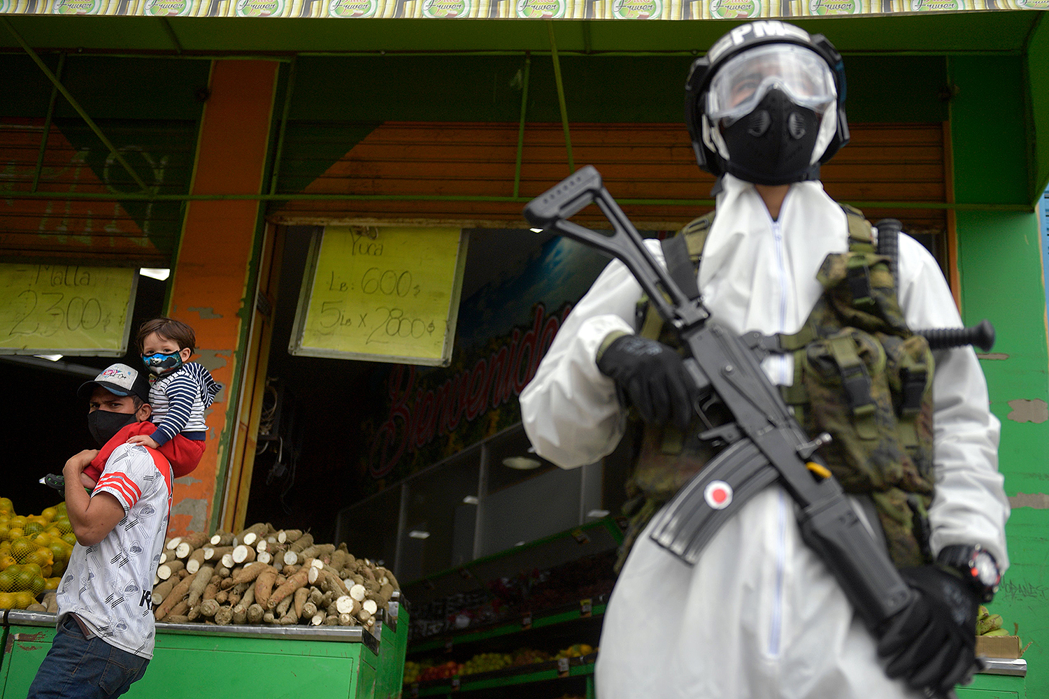 Colombian soldiers patrol the streets in Bogota on July 13 after a strict quarantine was declared to stop the spread of the coronavirus. RAUL ARBOLEDA/AFP via Getty Images