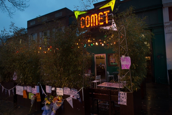 Signs of support hang outside the Comet Ping Pong pizzeria in Washington, D.C., on Dec. 6, 2016, after a man discharged his rifle claiming he was there to investigate a fake news story about a child sex ring.