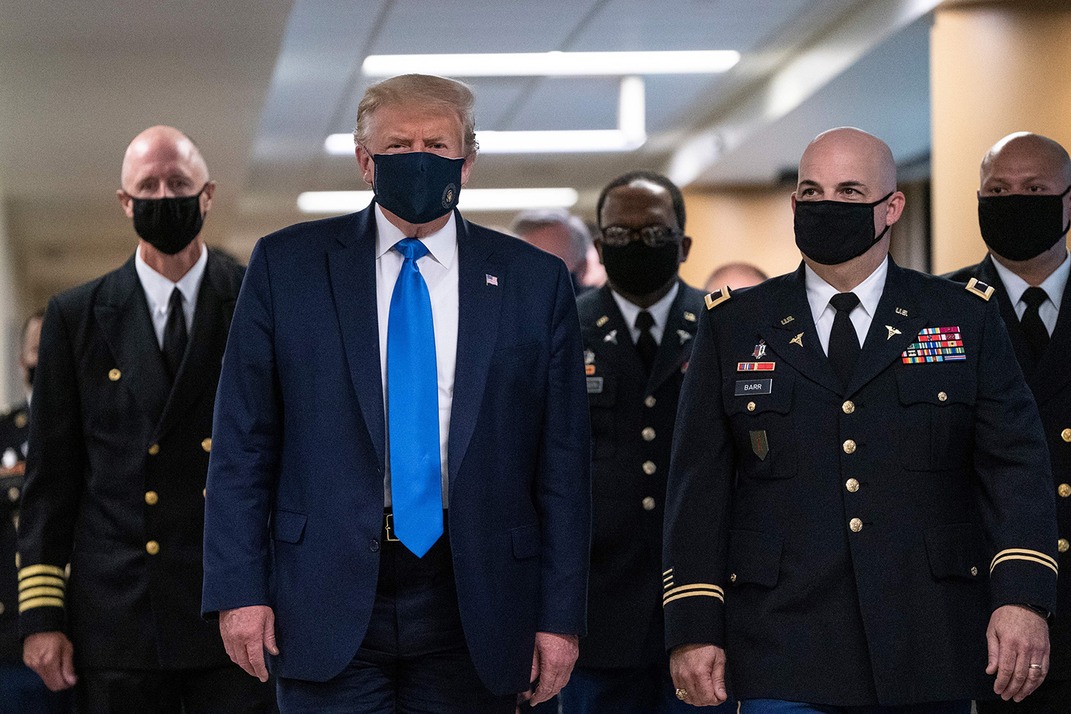 U.S. President Donald Trump wears a mask as he visits Walter Reed National Military Medical Center in Bethesda, Maryland, on July 11. ALEX EDELMAN/AFP via Getty Images