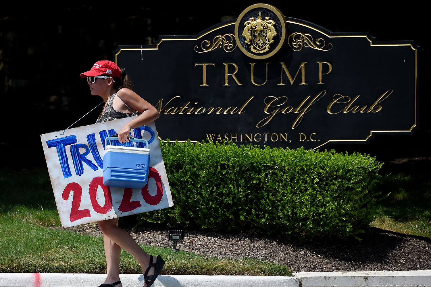 A supporter of President Donald Trump prepares to wait outside Trump National Golf Club in Sterling, Virginia, on July 19. OLIVIER DOULIERY/AFP via Getty Images