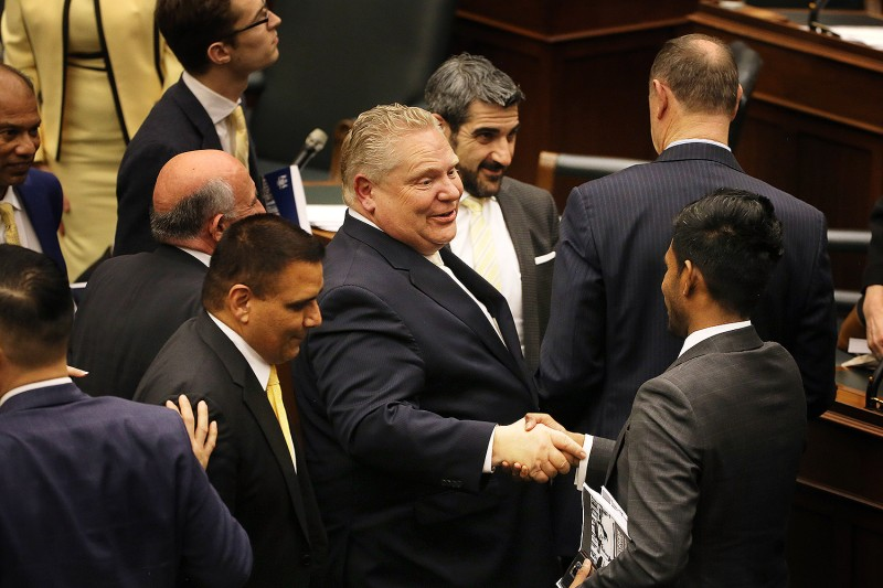 Ontario Premier Doug Ford shakes hands at the end of a government session in Toronto on April 11, 2019.