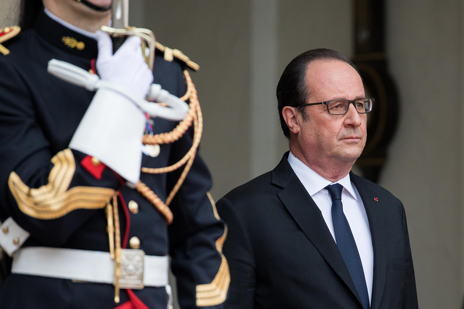 Former French President François Hollande awaits the arrival of the then French President-elect Emmanuel Macron during the transfer of power in Paris on May 14, 2017.