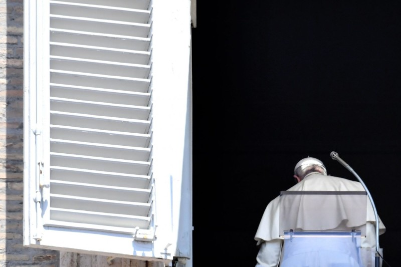 Pope Francis leaves the window of the Apostolic Palace overlooking St. Peter's Square in Vatican City after the Sunday Angelus prayer on July 22, 2018.