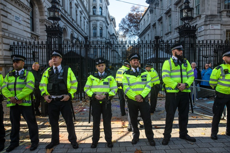 Police form a line during a protest near the British prime minister's residence on Downing Street on Nov. 14, 2018, in London.