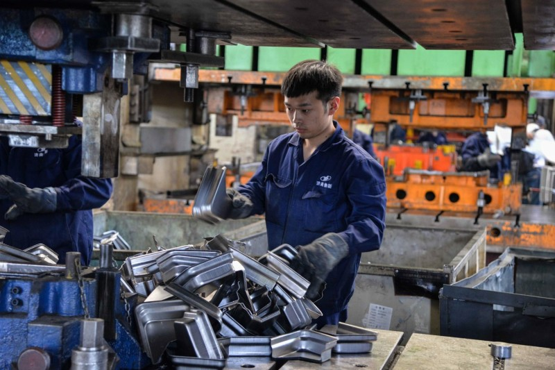 A Chinese employee works on vehicle parts at a factory in Jinan in China's eastern Shandong province on May 11, 2019.