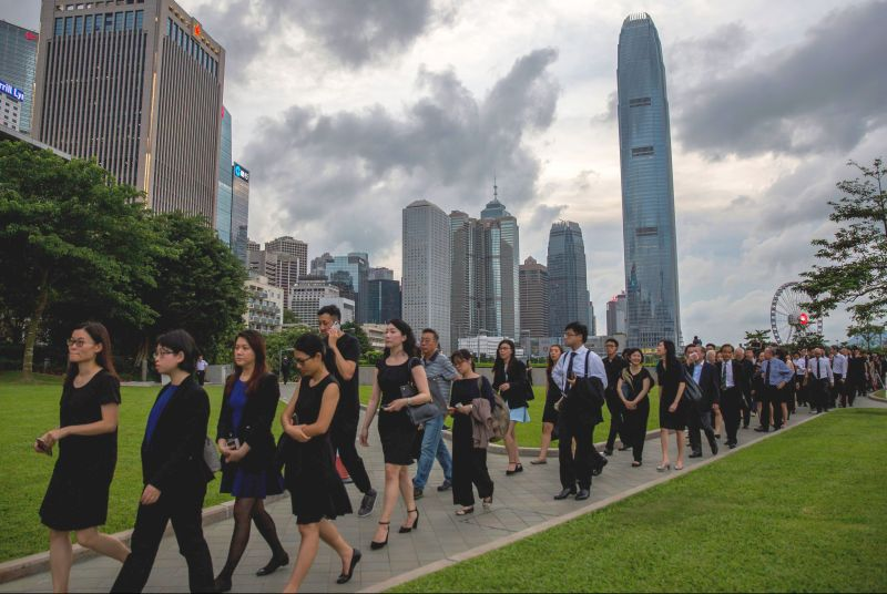 Legal professionals march to the Central Government Offices in Hong Kong to protest against the government's plan to approve extraditions to mainland China, on June 6, 2019.