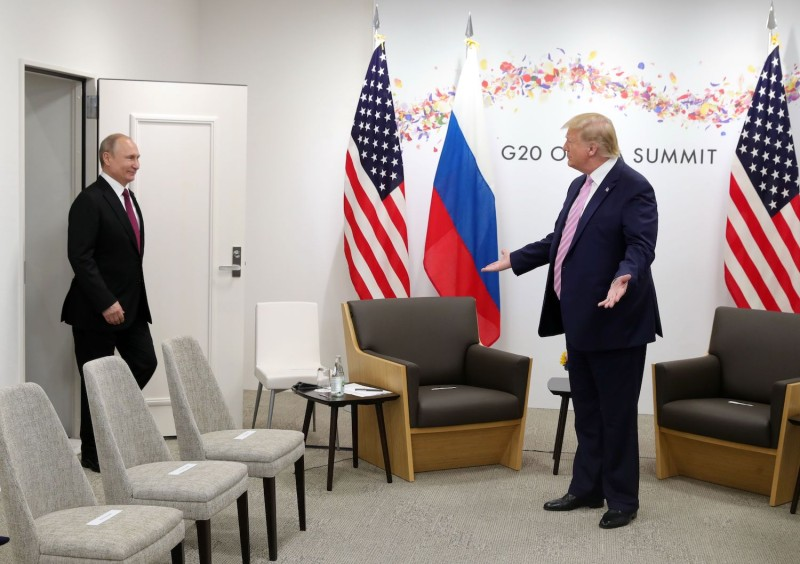 Russian President Vladimir Putin arrives for a meeting with US President Donald Trump on the sidelines of the G20 summit in Osaka on June 28, 2019.