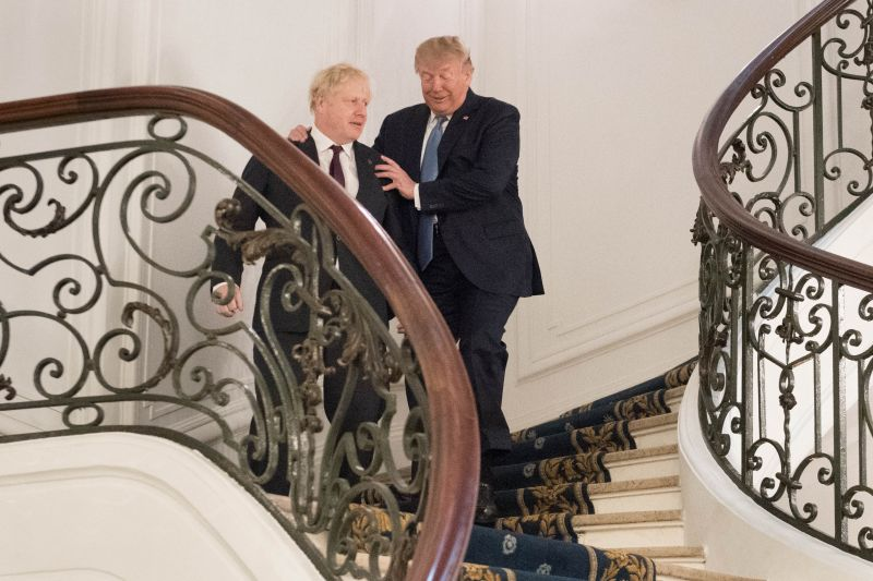 President Donald Trump and Britain's Prime Minister Boris Johnson arrive for a bilateral meeting during the G7 summit on Aug. 25, 2019 in Biarritz, France.
