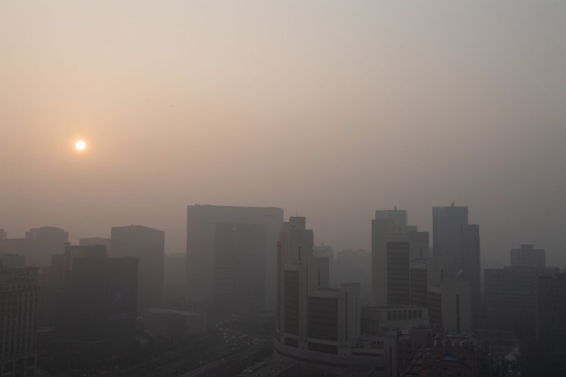 The sun sets on a polluted day in Beijing on Jan. 18.