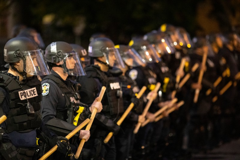 Police in riot gear stand in formation during protests on May 29 in Louisville, Kentucky.