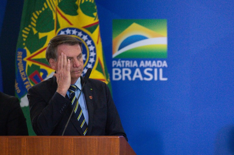 President of Brazil Jair Bolsonaro reacts during the swearing in ceremony for newly appointed Minister of Communications Fábio Faria amidst the coronavirus pandemic at the Planalto Palace on June 17, 2020 in Brasilia.