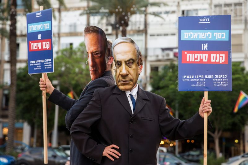 Demonstrators wear masks of Israeli Prime Minister Benjamin Netanyahu and Defense Minister Benny Gantz as they protest against plans to annex parts of the West Bank, on June 23 in Tel Aviv.
