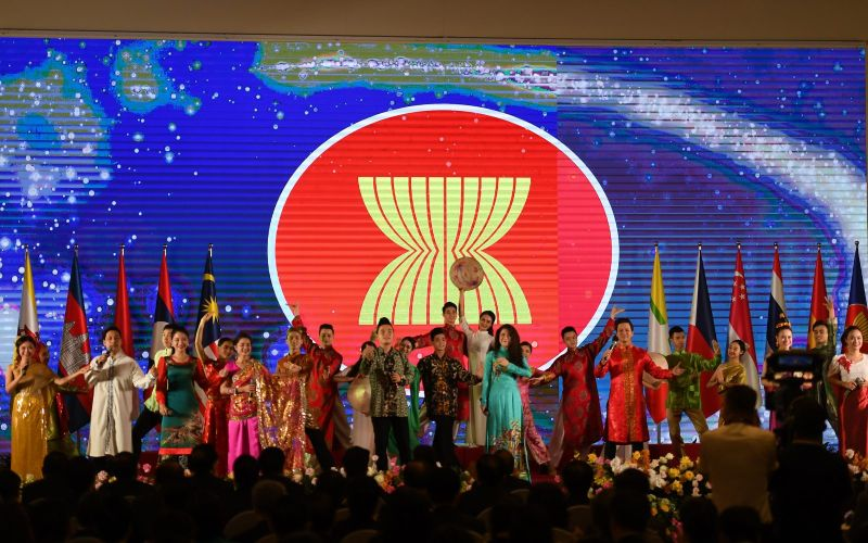 Artists perform on stage at the end of the opening ceremony of the 36th Summit of the Association of Southeast Asian Nations, held online due to the COVID-19 pandemic, in Hanoi on June 26.