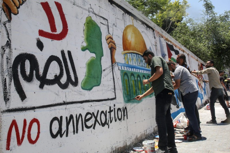 Palestinian artists draw murals depicting the Dome of the Rock and the West Bank as part of an awareness campaign against Israel's West Bank annexation plans, in Rafah in the southern Gaza Strip on July 1.