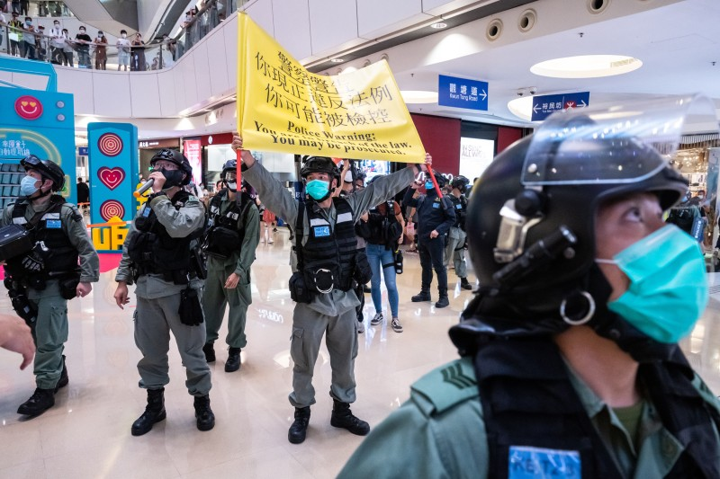 Riot police in a mall in Hong Kong