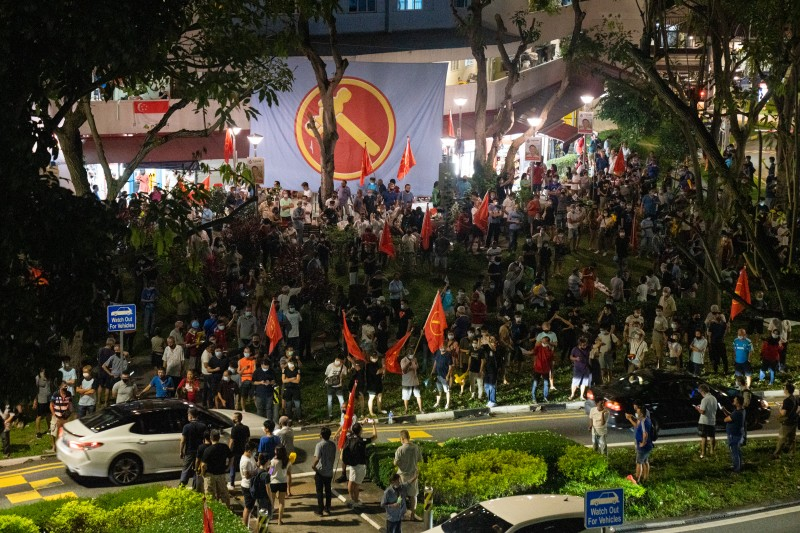 Supporters of the opposition Workers Party' gather and celebrate as results are announced during the general election in Singapore on July 11.