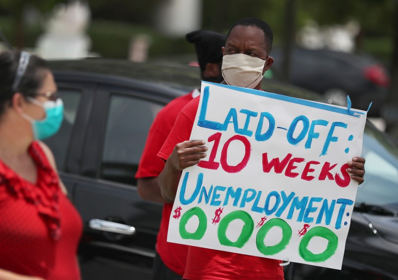A protest asking Florida to fix its unemployment system