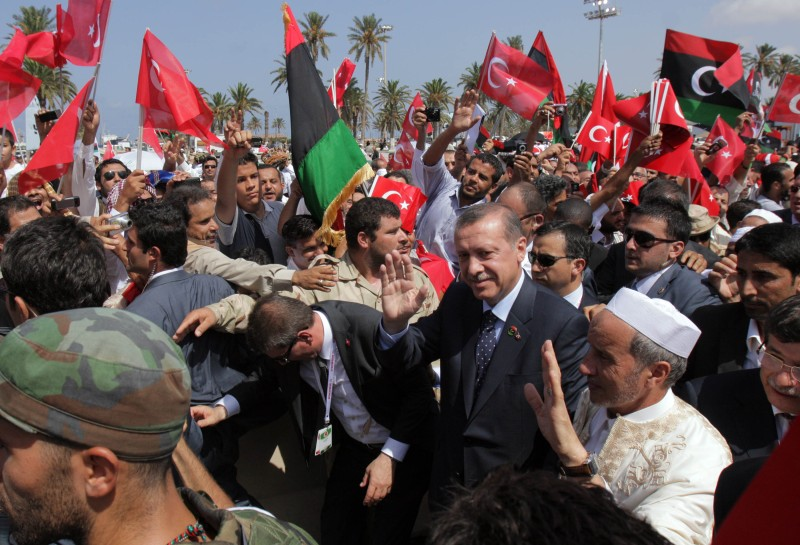 Turkish Prime Minister Recep Tayyip Erdogan and Libya's interim leader Mustafa Abdel Jalil wave as they attend Friday prayers in Tripoli on Sept. 16, 2011.