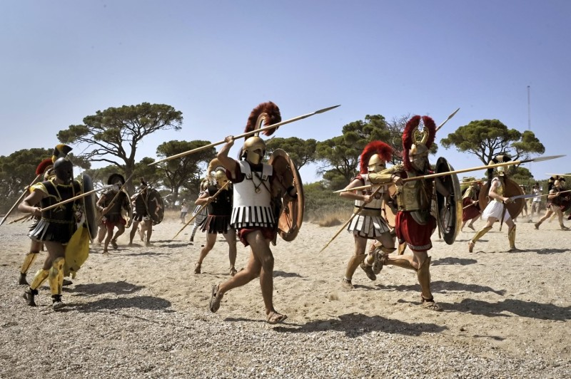 Reenactors dressed as Greek hoplites attack Persians during an event  to commemorate the 2,500-year anniversary of the Battle of Marathon in Marathon, Greece, on Sept. 10, 2011.