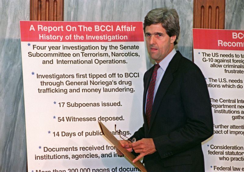 Senator John Kerry addresses reporters October 1, 1992 at the U.S. Capitol about the release of the Senate Foreign Relations Subcommittee on Terrorism's report on the Bank of Credit and Commerce International's (BCCI) illegal financial dealings.
