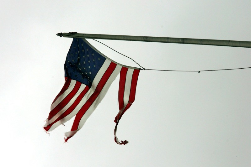 A tattered American flag blows in the winds of Hurricane Dennis in Mobile, Alabama, on July 10, 2005.