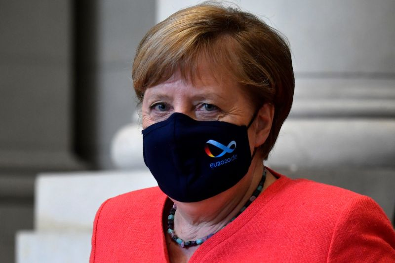 German Chancellor Angela Merkel wears a face mask with the logo of Germany's EU presidency as she leaves the German Federal Council after a speech in Berlin on July 3.